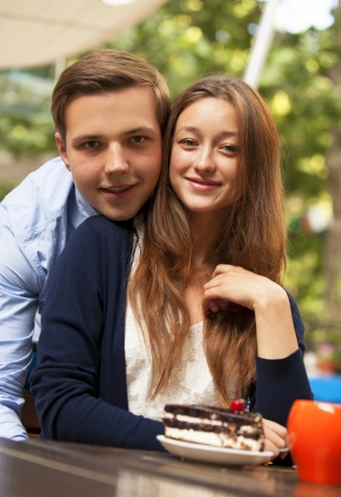 sweet seventeen: young couple in the cafe