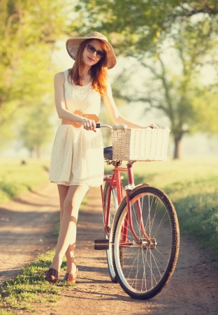 Girl on a bike in the countryside. photo