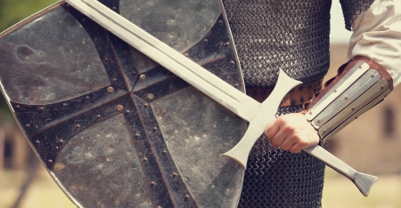 sword fighting: Knight. Photo in vintage style. Stock Photo