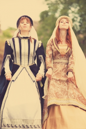 Two medieval ladys at outdoor photo