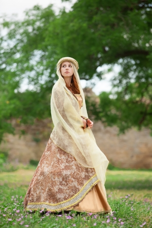 medieval dress: Medieval lady at outdoor. Stock Photo