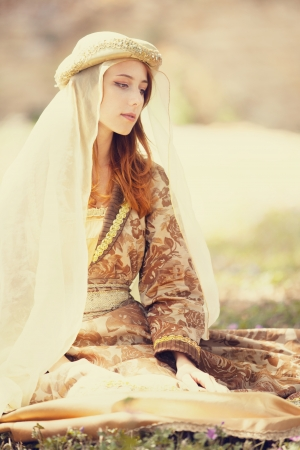 redhead: Medieval lady at outdoor. Stock Photo