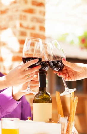 Couple drinking wine in the cafe photo