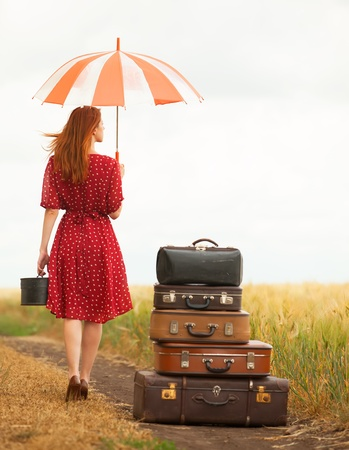 the enchantress: Redhead girl with suitcases at outdoor