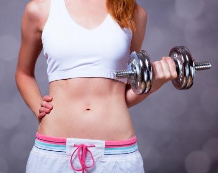 skinny woman: Girl with dumbbell Stock Photo