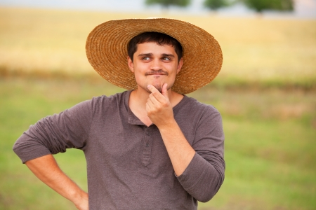 Surprised farmer at wheat field photo