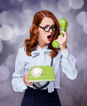 Women with green telephone Stock Photo - 20676562