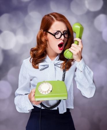 Women with green telephone Stock Photo - 20676562