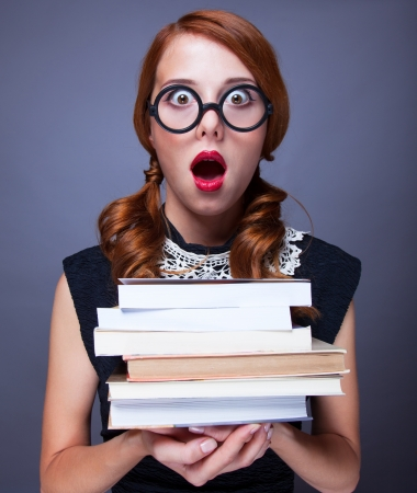 faculty: Surprised girl with books
