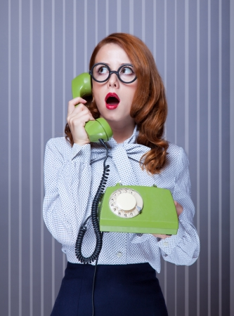 retro phone: Women with green telephone