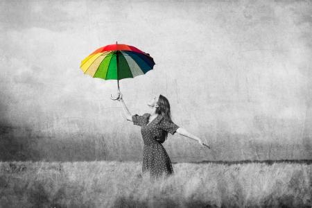 Redhead girl with umbrella at field Zdjęcie Seryjne