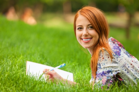 beautiful young woman with note at outdoor photo