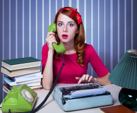 skeptic: Woman at typewriter on telephone Stock Photo