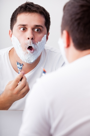 Surprised real men shaving. photo