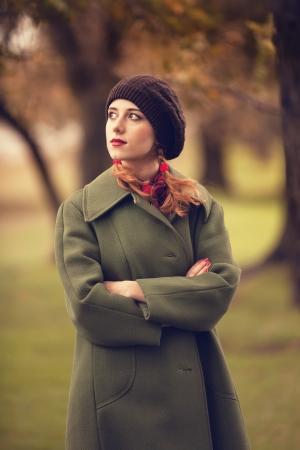 Style redhead girl at beautiful autumn outdoor Stock Photo - 21111624