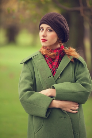 the enchantress: Style redhead girl at beautiful autumn outdoor
