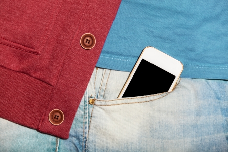 Mobile phone in jeans pocket Stock Photo - 21111754