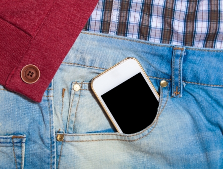 Mobile phone in jeans pocket Stock Photo - 21111756