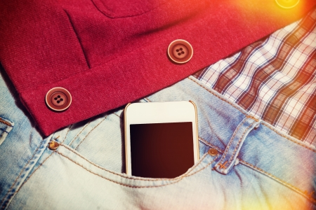 Mobile phone in jeans pocket Stock Photo - 21111758