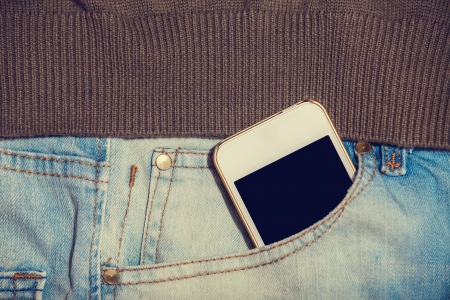 Mobile phone in jeans pocket Stock Photo - 21111759