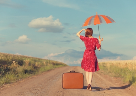 Redhead girl with umbrella and suitcase at outdoor Stock Photo - 21111763