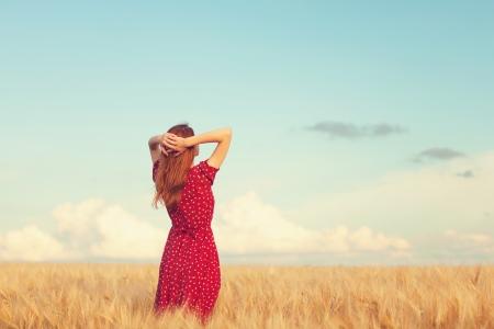 the enchantress: Redhead girl at wheat field