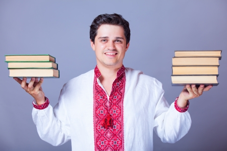 purl: Man in embroidery shirt with books. Ukrainian national clothes.  Stock Photo