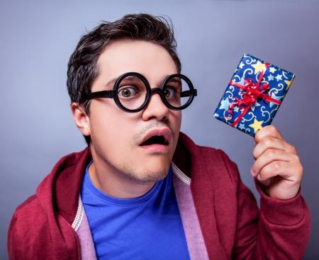 crazy man: Crazy man with gift. Studio shot.