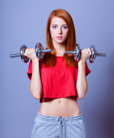 loose skin: Girl with dumbbells