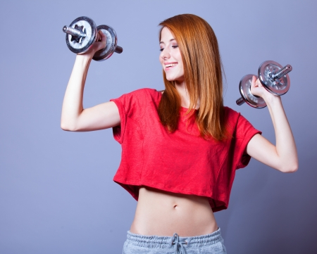 Girl with dumbbells photo