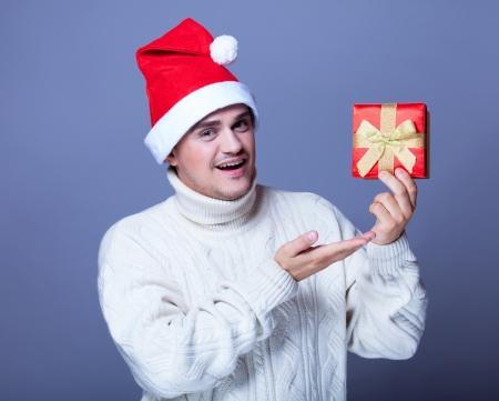Guy with present and hat photo