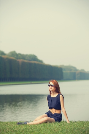 Beautiful women in versailles garden photo