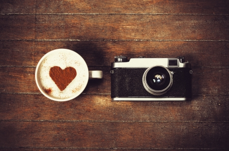 romance image: Cup of coffee with retro camera