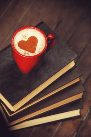 Cup of coffee with books photo