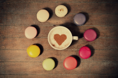 macrons with cup of coffee photo