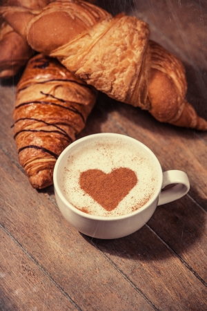 Cup of coffee with french croissant photo
