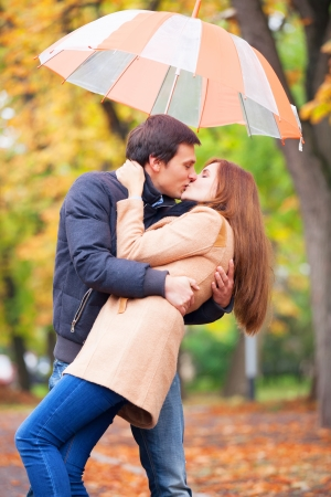 couple kissing at outdoor in the park photo