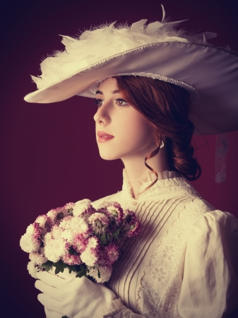 victorian lady: Beautiful redhead women with bouquet