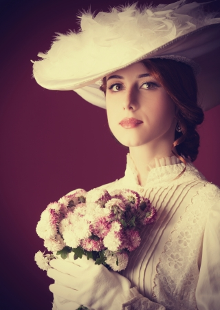 victorian style: Beautiful redhead women with bouquet