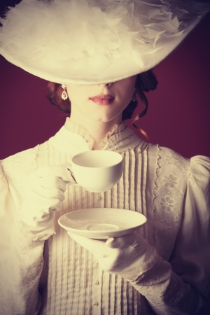 lady: Beautiful redhead women with cup of tea