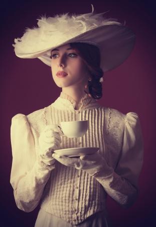 woman: Beautiful redhead women with cup of tea