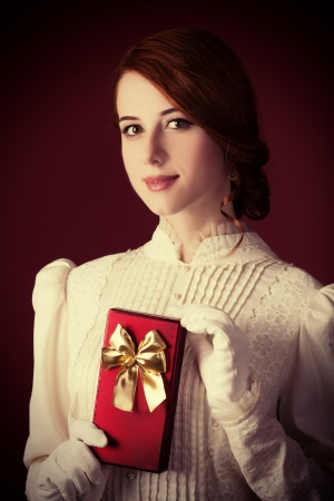 Beautiful redhead women with gift photo
