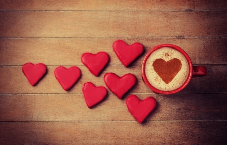 candy hearts: Cup of coffee with heart symbol and candy around. Stock Photo