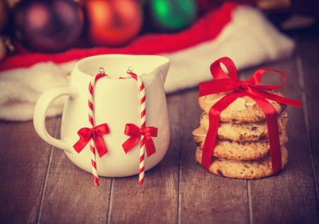 Cookies, earrings and christmas gifts at background Stock Photo
