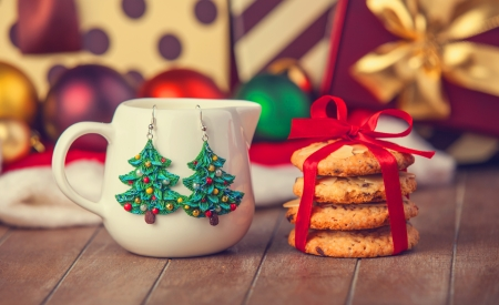 Cookies, earrings and christmas gifts at background photo
