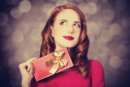 Redhead women with gift. photo