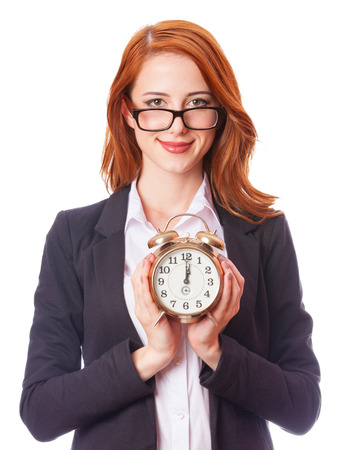 Redhead girl with clock on white