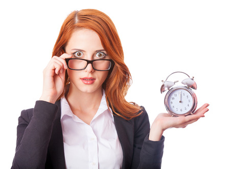 Redhead girl with clock on white  photo