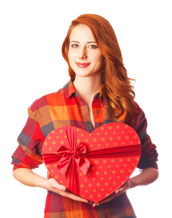 Redhead girl with gift. Photo on white  photo