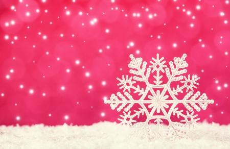 snowflake border: Snowflake on red background. Christmas time